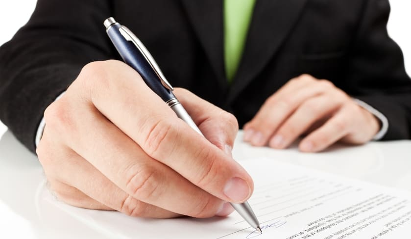 pen signing settlement contract possession property investment