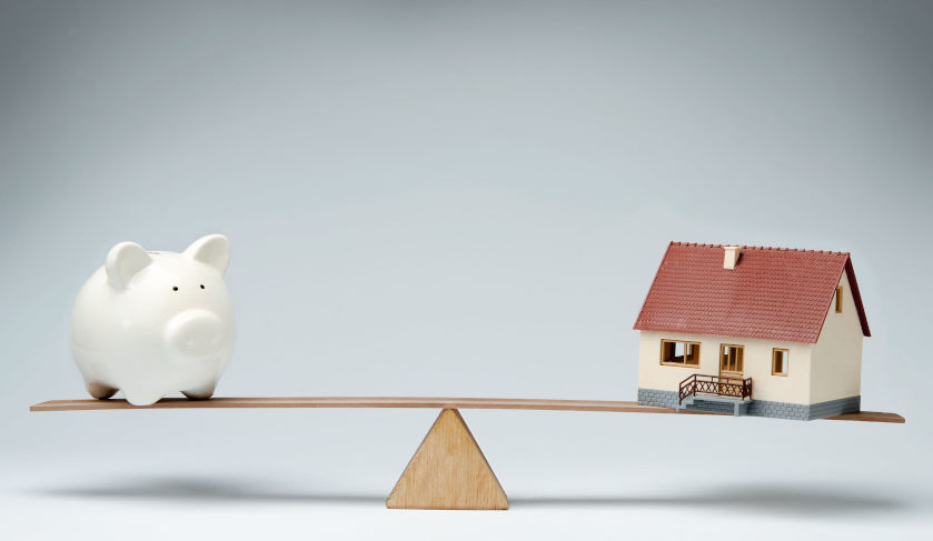 Balance between piggy bank and a property house