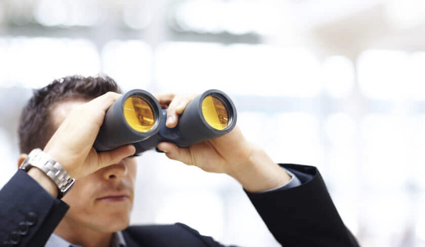adelaide perth darwin where to invest investor looking at binoculars