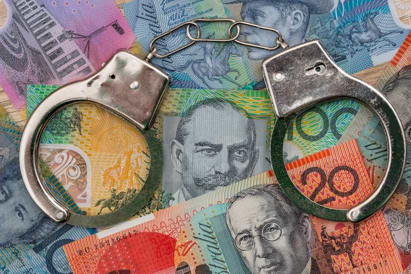 Australian money and handcuffs