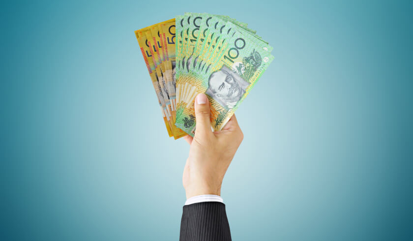 Businessman holding Australian dollars