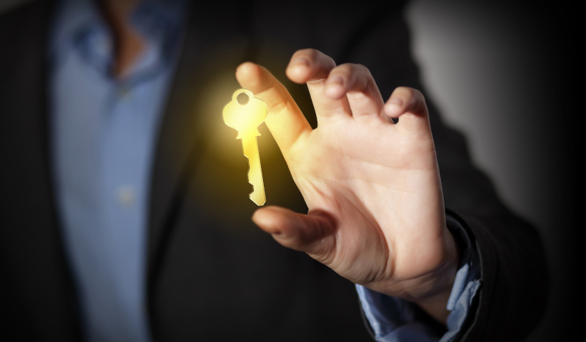 Man holding glowing key