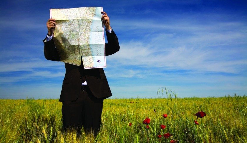 A lost businessman with a map