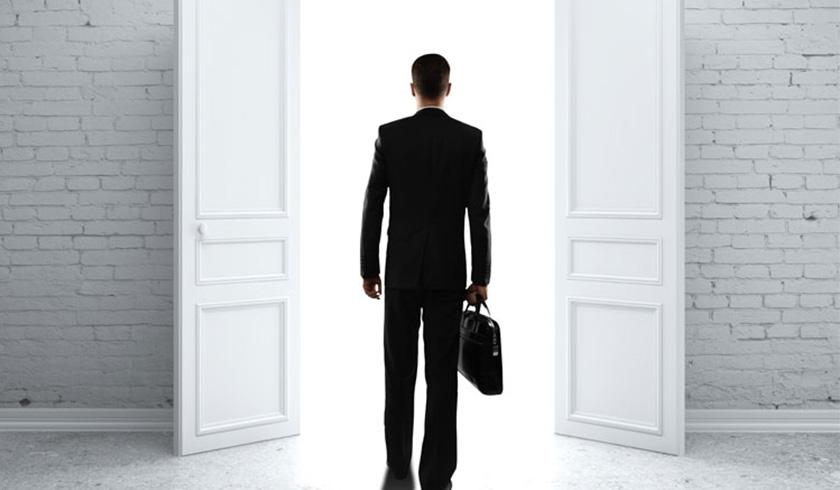 Man exits door