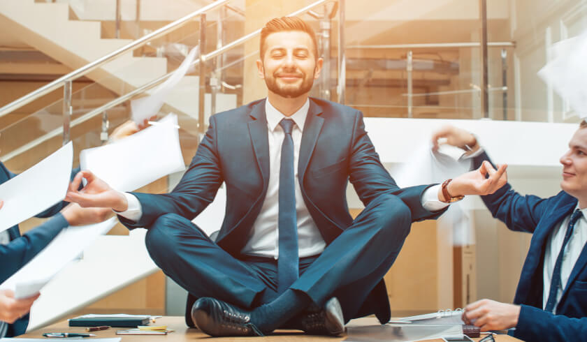 Man in a suit meditating