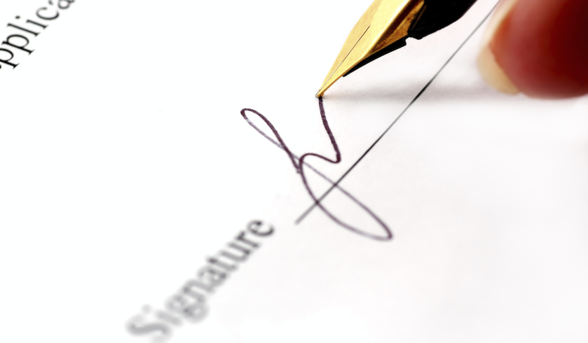Pen signing a paper