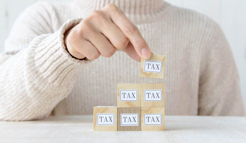 wooden block tax cubes building capital gains tax property portfolio