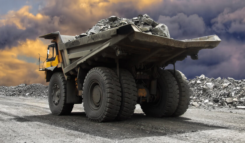 mining truck construction investing in mining towns